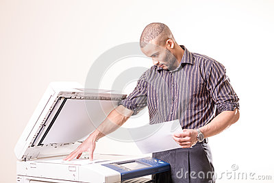 Office man making copies of documents