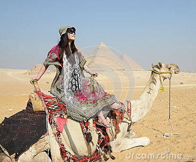 Woman riding camel