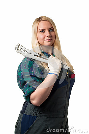 Workwoman with a big wrench