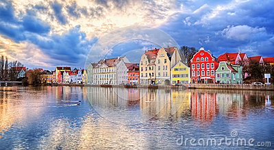 Colorful gothic houses reflecting in Isar river on sunset, Lands