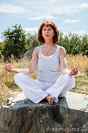 Older yoga woman seeking for spiritual peace