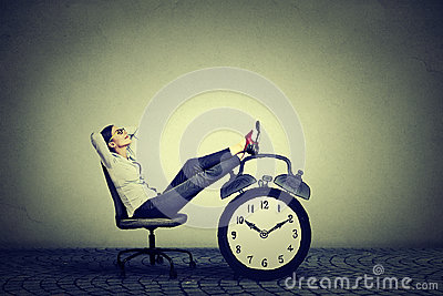 stock image of business woman relaxing sitting in office. stress free time management concept