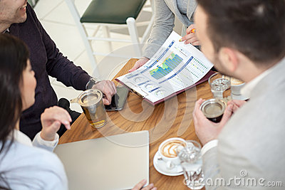 Group of business people  meeting in coffee shop and holding a b
