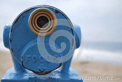 Close up blue telescope view point looking out to sea with copy space to the