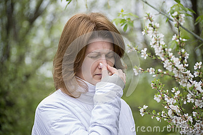 Adult female with allergic rhinitis about  cherry blossoms
