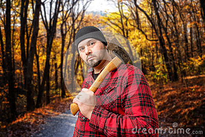 Lumberjack Woodsman In Forest Fall Foliage