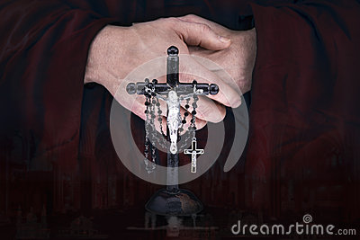 Mystery monk's hands with a cape, crucifix and a black rosary