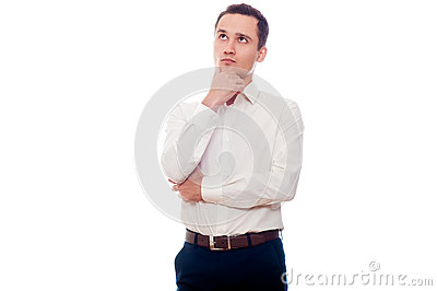 Young man in business suit thinking. Businessman making decision