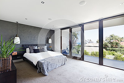 Spacious interior of designer master bedroom in luxury Australia