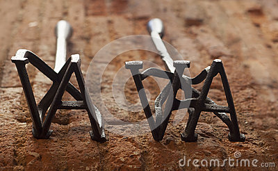 Two rustic branding irons for cattle