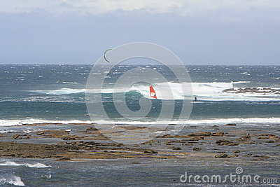 Kite surfer and wind surfer