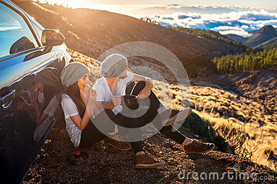 Couple having picnic near the car