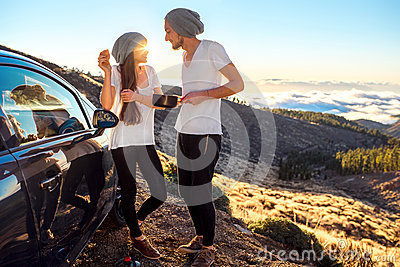 Couple eating having picnic near the car