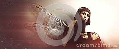 Delicate, feminine fragility. Young woman with wings.