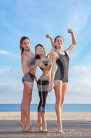 Group of young fit athletes