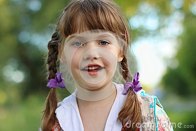 Close up portrait of pretty smiling little girl