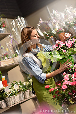 Portrait of young woman in flower shop