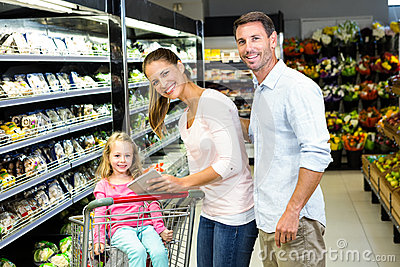 Happy family checking grocery list