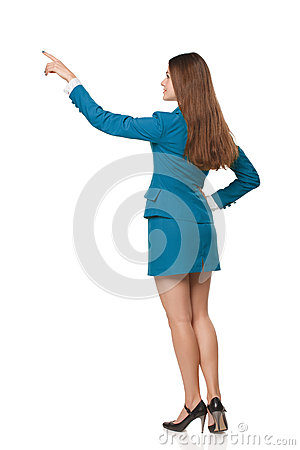 Back view of full length business woman in pointing at copy space, isolated on white