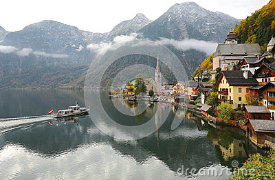 Scenic postcard view of famous Hallstatt village by Hallstattersee Lake in the Austrian Alps