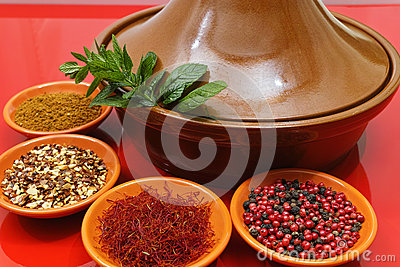 Moroccan tahine with four bowls with spices and fresh mint