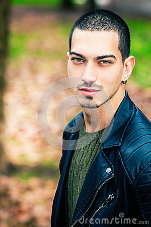 Handsome young man outdoors, short hair style