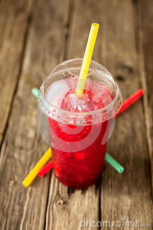 Frozen Red Slushie in Plastic Cup with Straw