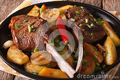 Beef steak with chili and a side dish of potatoes close up. hori
