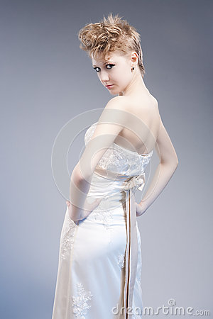 Beauty and Fashion Concepts. Young Sexy Blond Woman in Nicely Tailored Dress