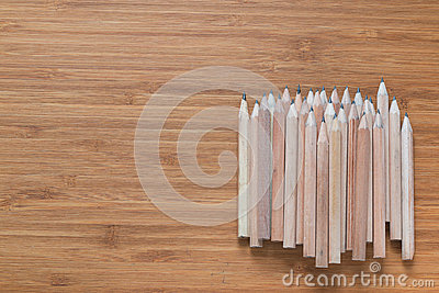 Pile of wooden pencils lying on the desk. Background for office themes.