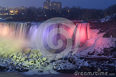 Niagara Falls frozen at night with colorful lights