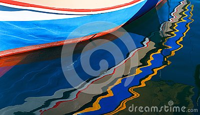 Fishing boat with reflection,legendary and iconic colorful,colorful reflection of fishing boats in Malta