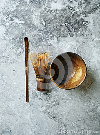 Measure spoon, bamboo whisk and ceramic cup for matcha tea