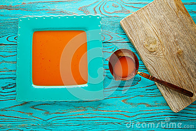 Tomato sauce on square turquoise dish
