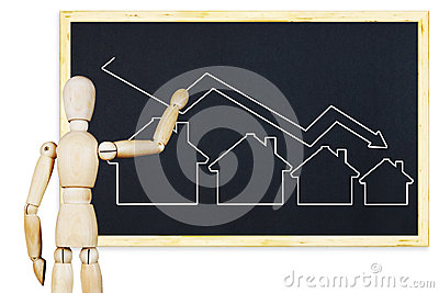 Man draws a graph of falling sales of real estate on a blackboard