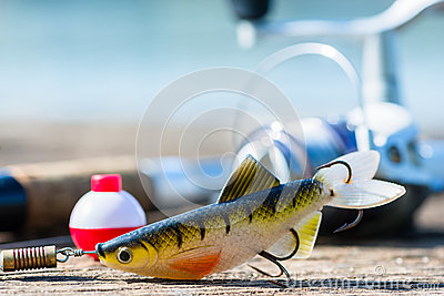 Fishing rod, lure, and hook on jetty
