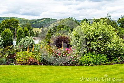 Beautiful walled, victorian garden with variety of flowers and trees