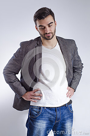 Stylish young adult man posing