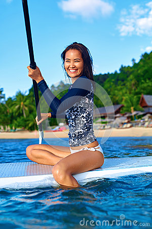 Travel Adventure. Woman Paddling On Surfing Board. Recreation, W