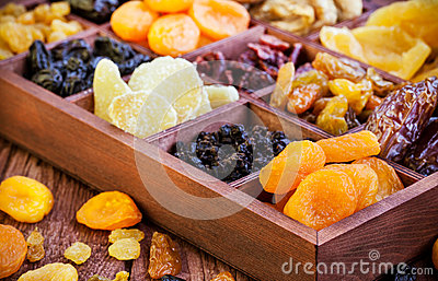 Assorted dried fruits in wooden box