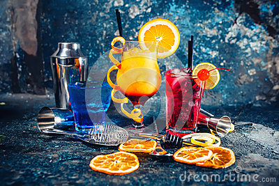Alcoholic booze served cold at bar, drinks and refreshments with garnish