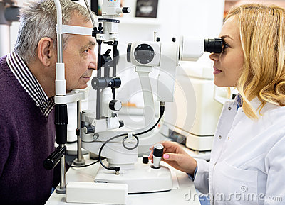 Female ophthalmic doctor check eyes  man in eye clinic