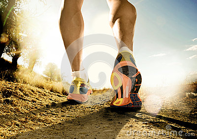 stock image of strong legs and shoes of sport man jogging in fitness training workout on off road
