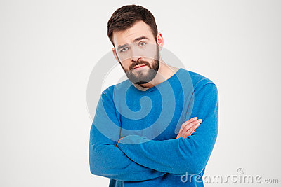 Serious man with arms folded