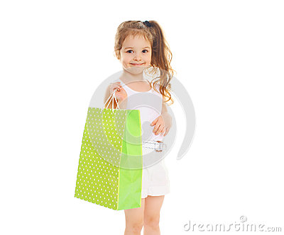 Beautiful little girl child with shopping paper bag on white