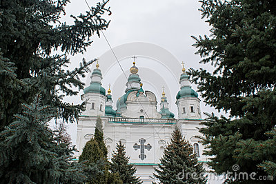 Big white ancient christian cathedral with crosses