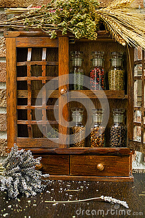 Vintage Wooden Spice Rack or Storage Cabinet and six glass bottl