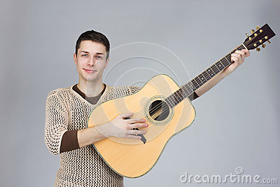 stock image of the guy is a musician with a guitar on gray
