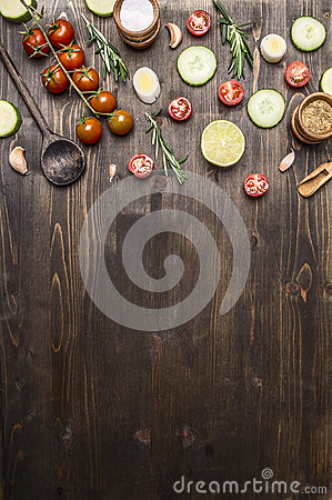 Ingredients for cooking vegetarian food wooden spoons, cherry tomatoes, dill, parsley, pepper border ,place text  on wooden ru