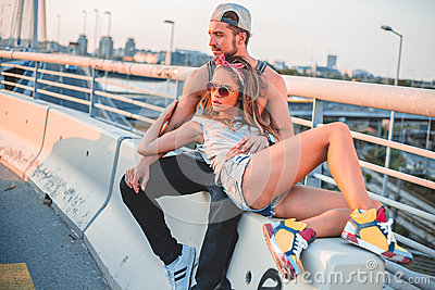 Couple lying on the bridge